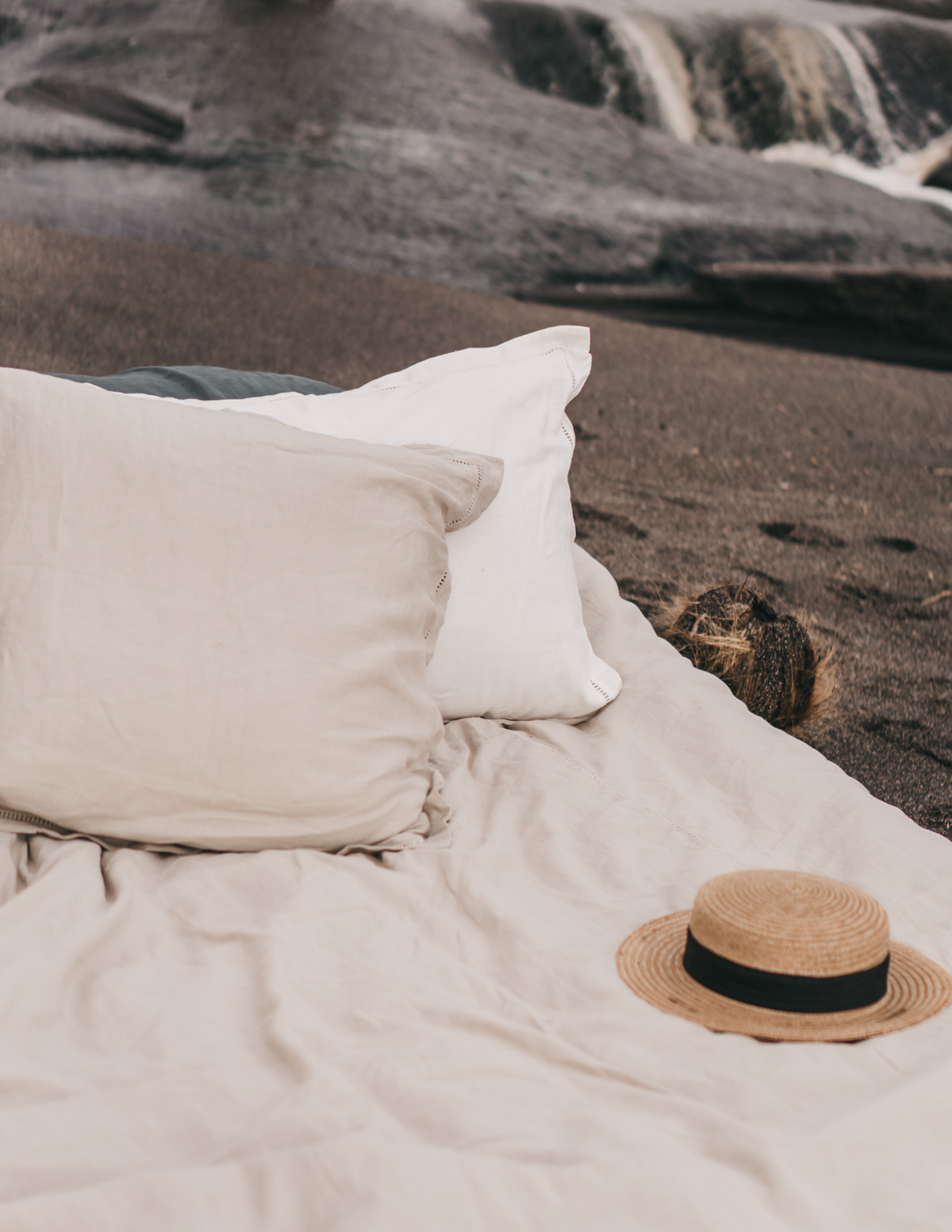 Keira-Mason-in-between-the-sheets-staraw-hat-at-beach.jpg