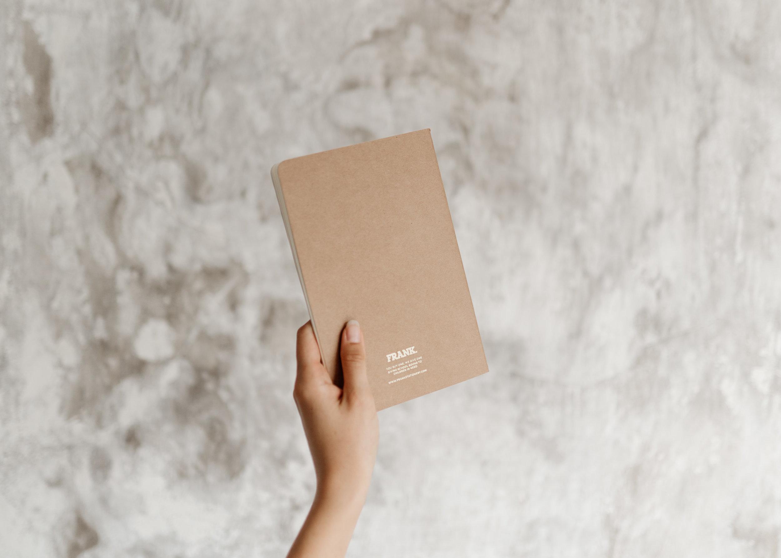 keira-mason-frank-stationery-holding-journal.jpg