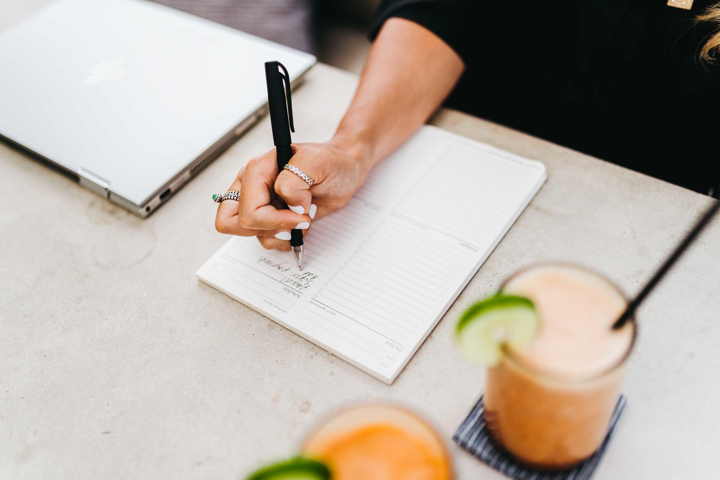 keira-mason-zest-bookkeeping-solutions-writing-down-list.jpg
