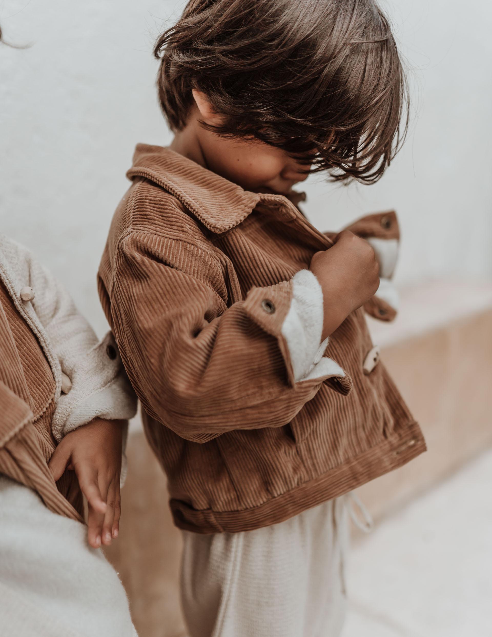 keira-mason-illoura-the-label-boy-putting-on-jacket.jpg