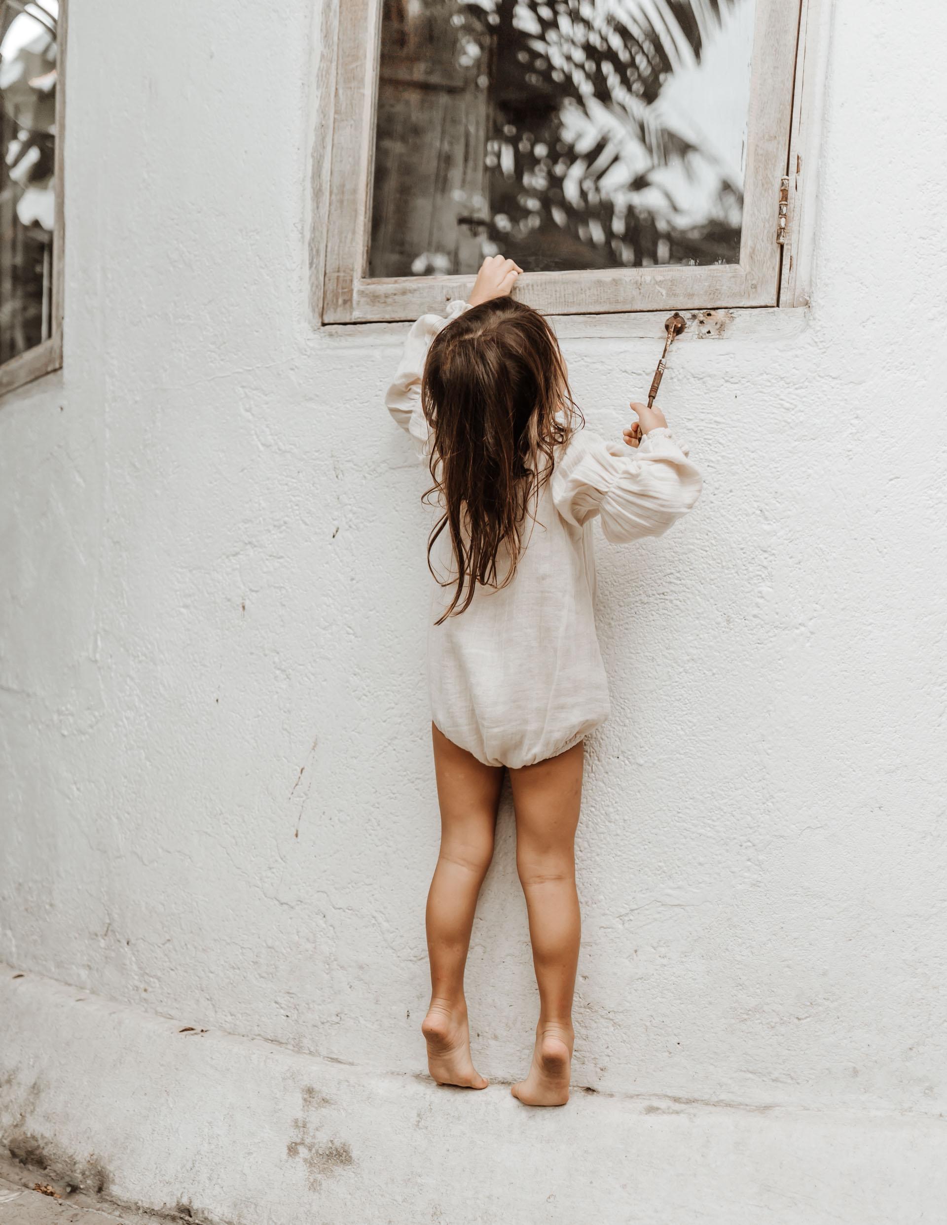 keira-mason-illoura-the-label-girl-reaching-for-window.jpg