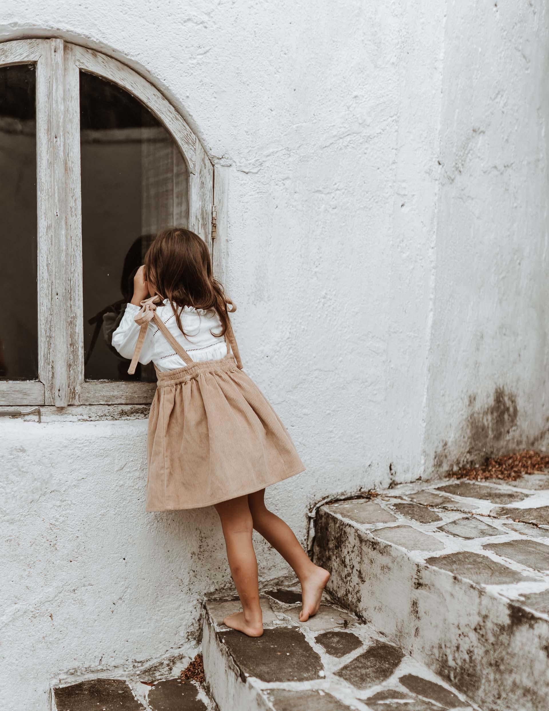 keira-mason-illoura-the-label-girl-looking-in-wondow-in-dress.jpg