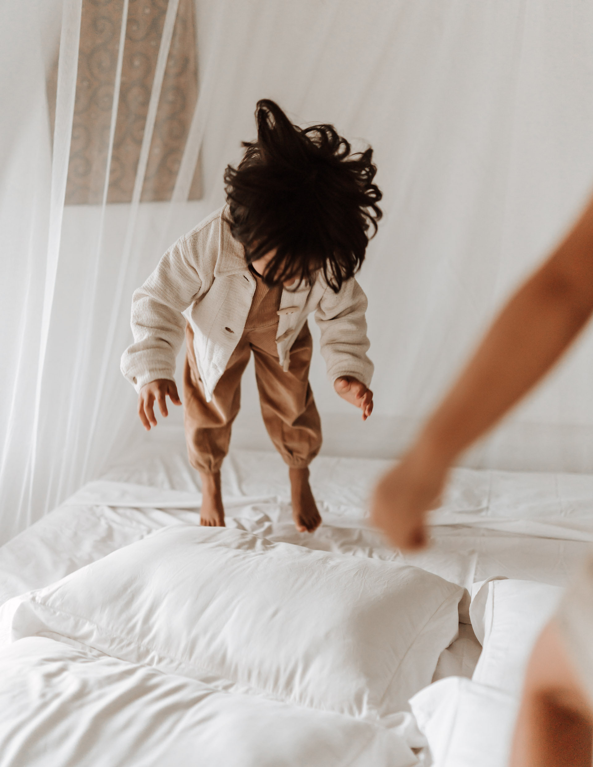 keira-mason-illoura-the-label-boy-jumping-on-bed.jpg