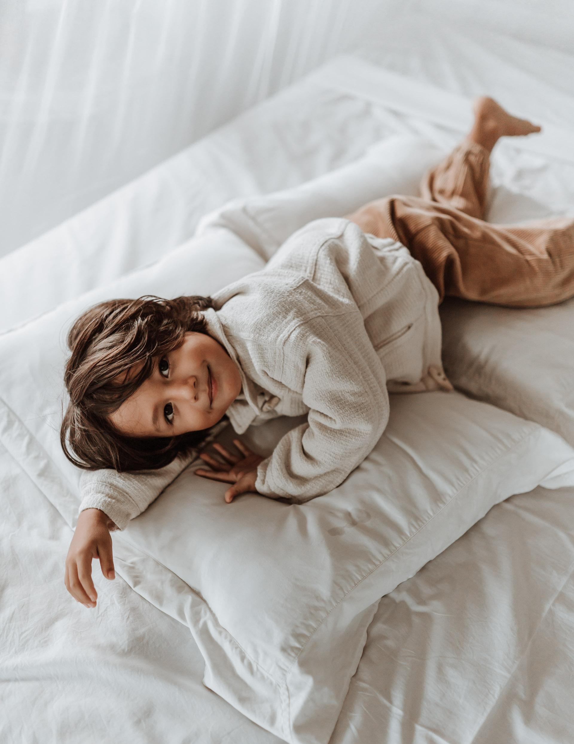 keira-mason-illoura-the-label-boy-in-jacket-on-bed.jpg