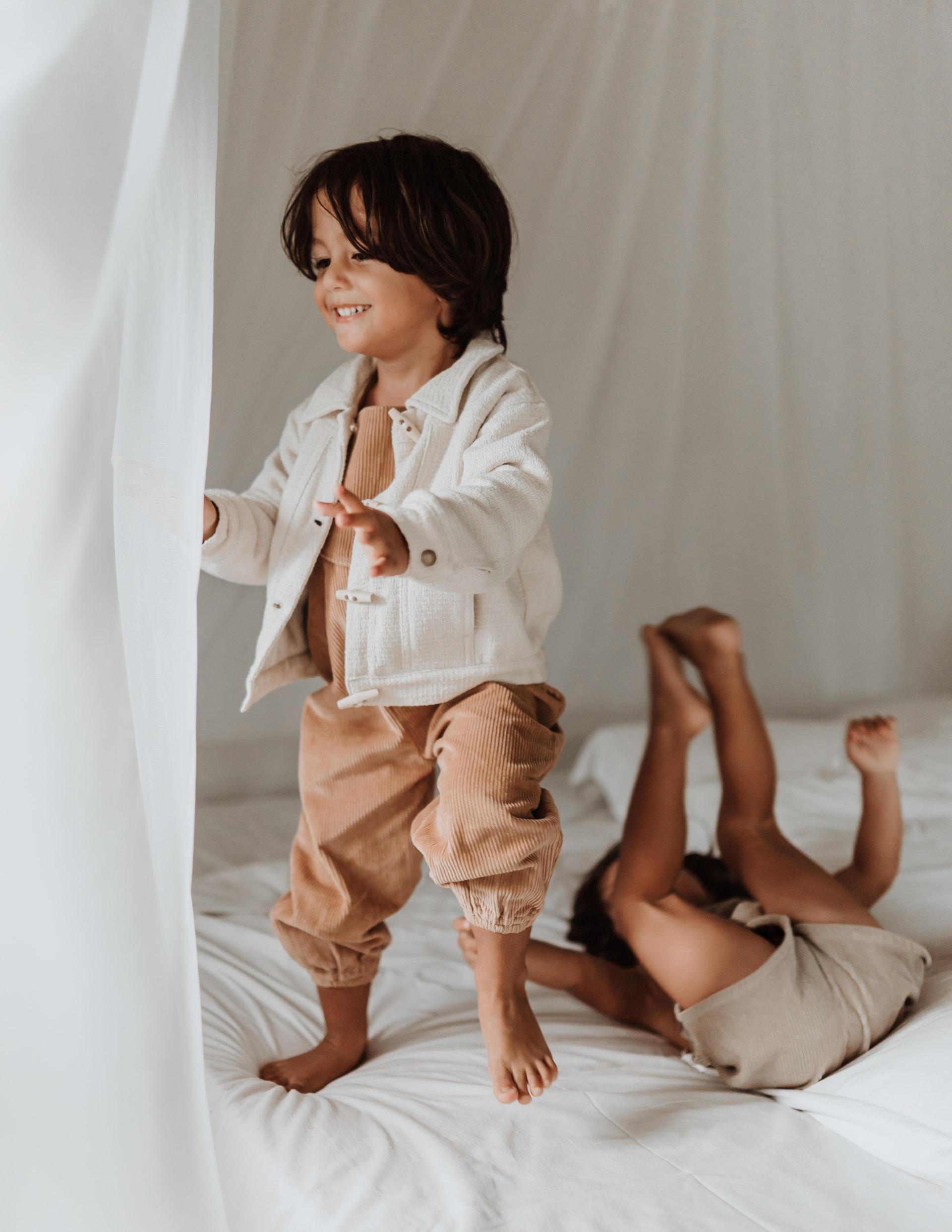 keira-mason-illoura-the-label-boys-playing-on-bed.jpg