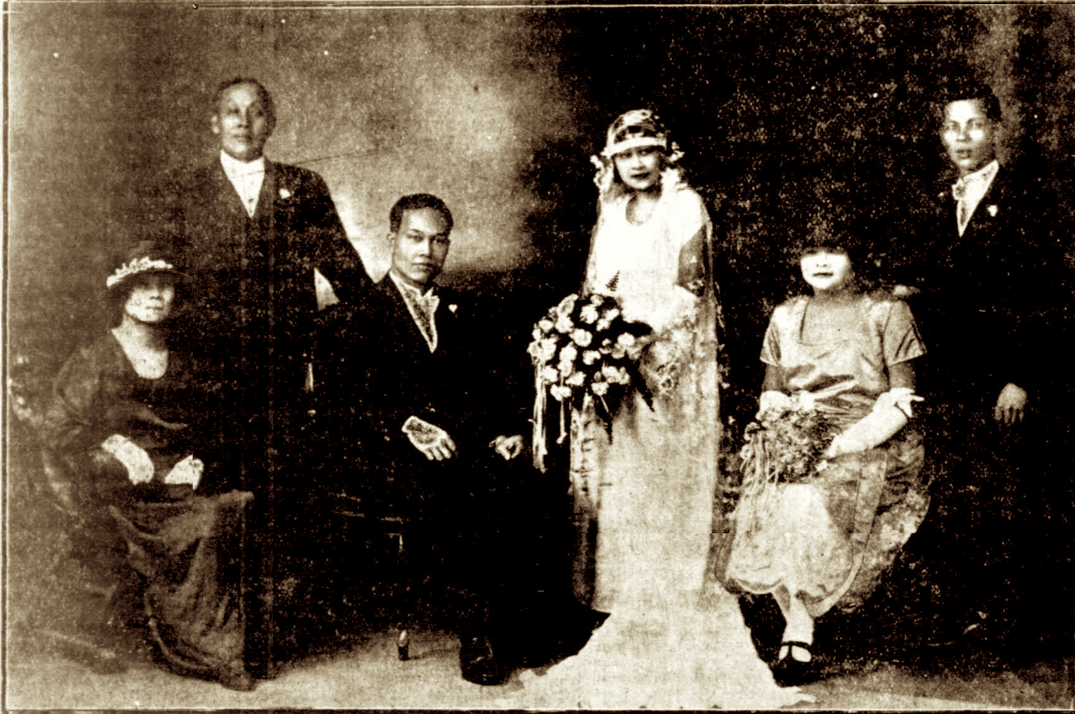 Mirror, 25 July 1925: The wedding of Leong Yen and Ruby Lee Wood, June 1924. Ruby's parents are on the left; her unmarried sister Dolly, on her right.