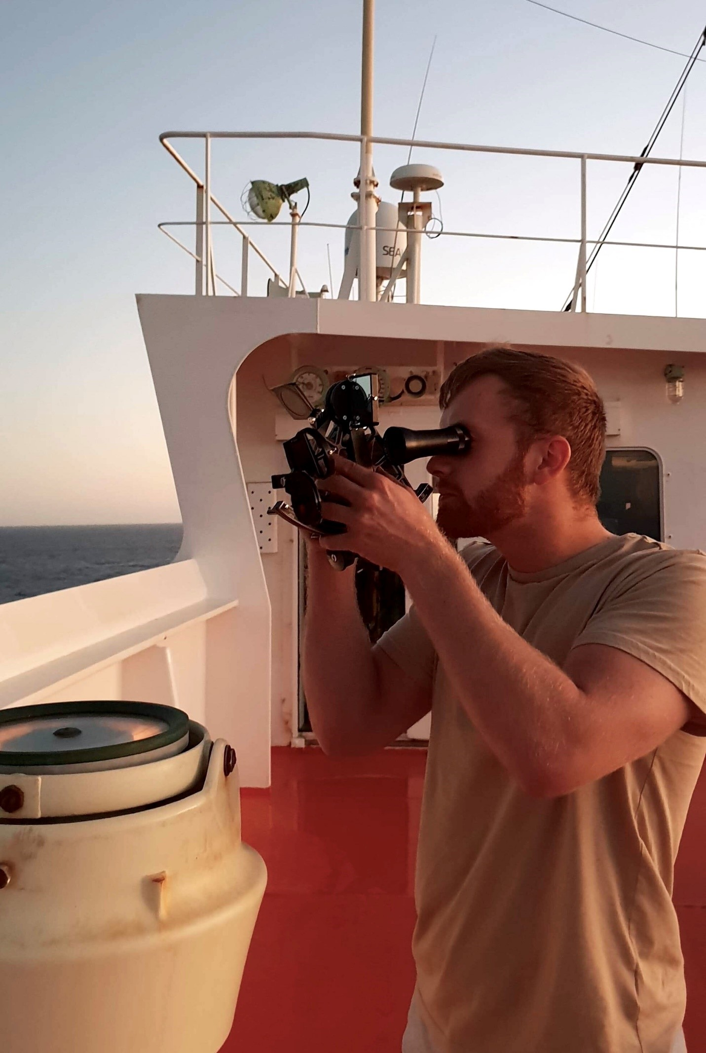 Image: Henrik Reiten on board the MV Banastar, operating a sextant to find the position of the vessel