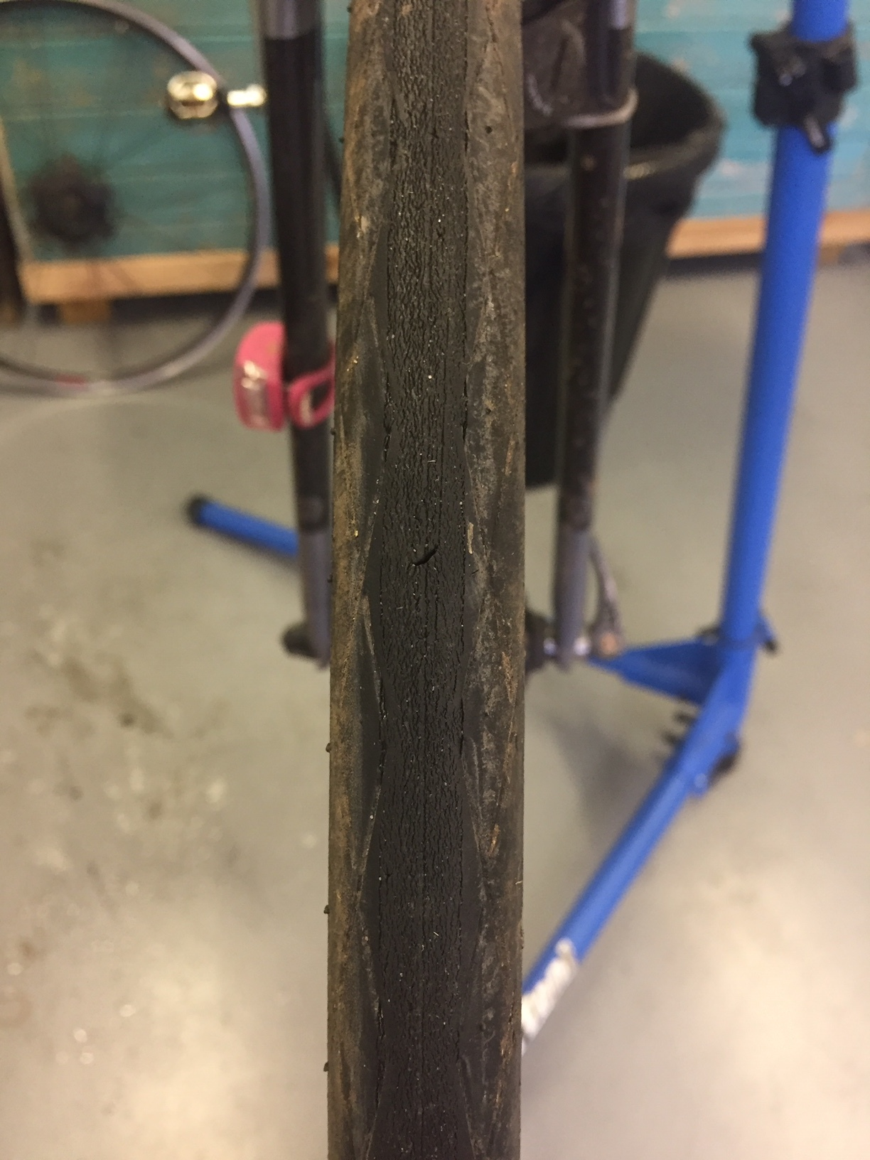 We look for cuts in tyres —> - You can also see tyre 'fatigue' - tiny cracks in the tyre - another sign it's ready to be replaced.