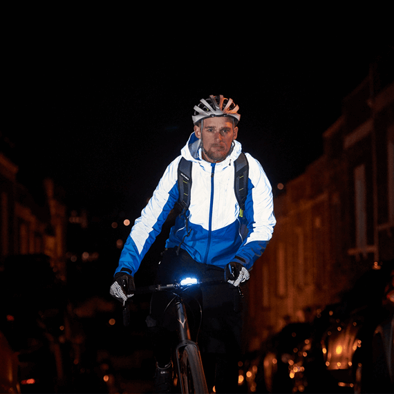 Under artificial light - The Altura Thunderstorm jacket has a completely different look, helping riders to stand out and be seen by drivers. The rider is also using a set of Altura gloves with reflective detailing. (Image taken from Altura website)