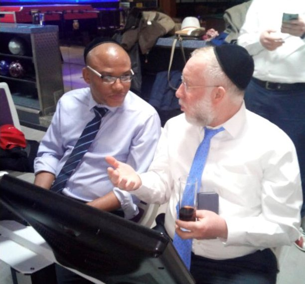Kanu speaking with Chief Rabbi of Munich Shmuel Brodman