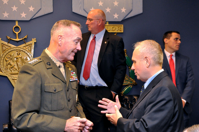 Bob Curry  and the General Joseph F. Dunford, Jr. is the 19th Chairman of the Joint Chiefs of Staff, the nation's highest-ranking military officer, and the principal military advisor to the President, Secretary of Defense, and National Security Council Receiving a Wall of Heres award in helping our retuning veterans.