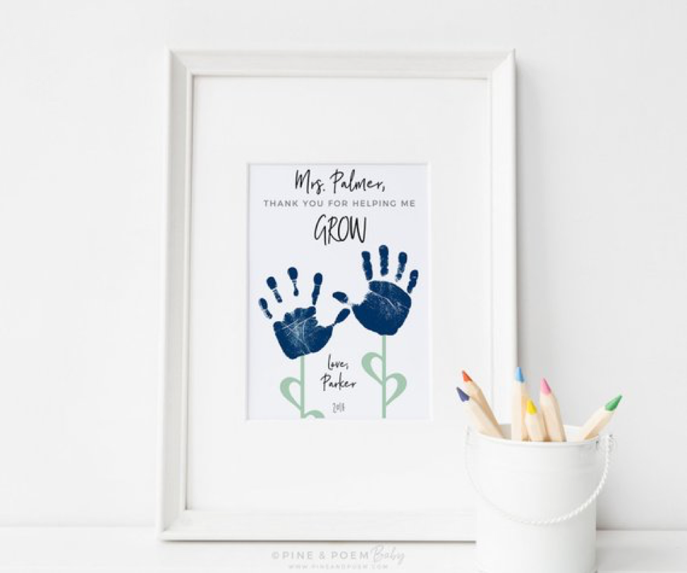 - Decorate her Walls. Beautiful framed handprints with a customizable message from Etsy Pine and Poem Baby