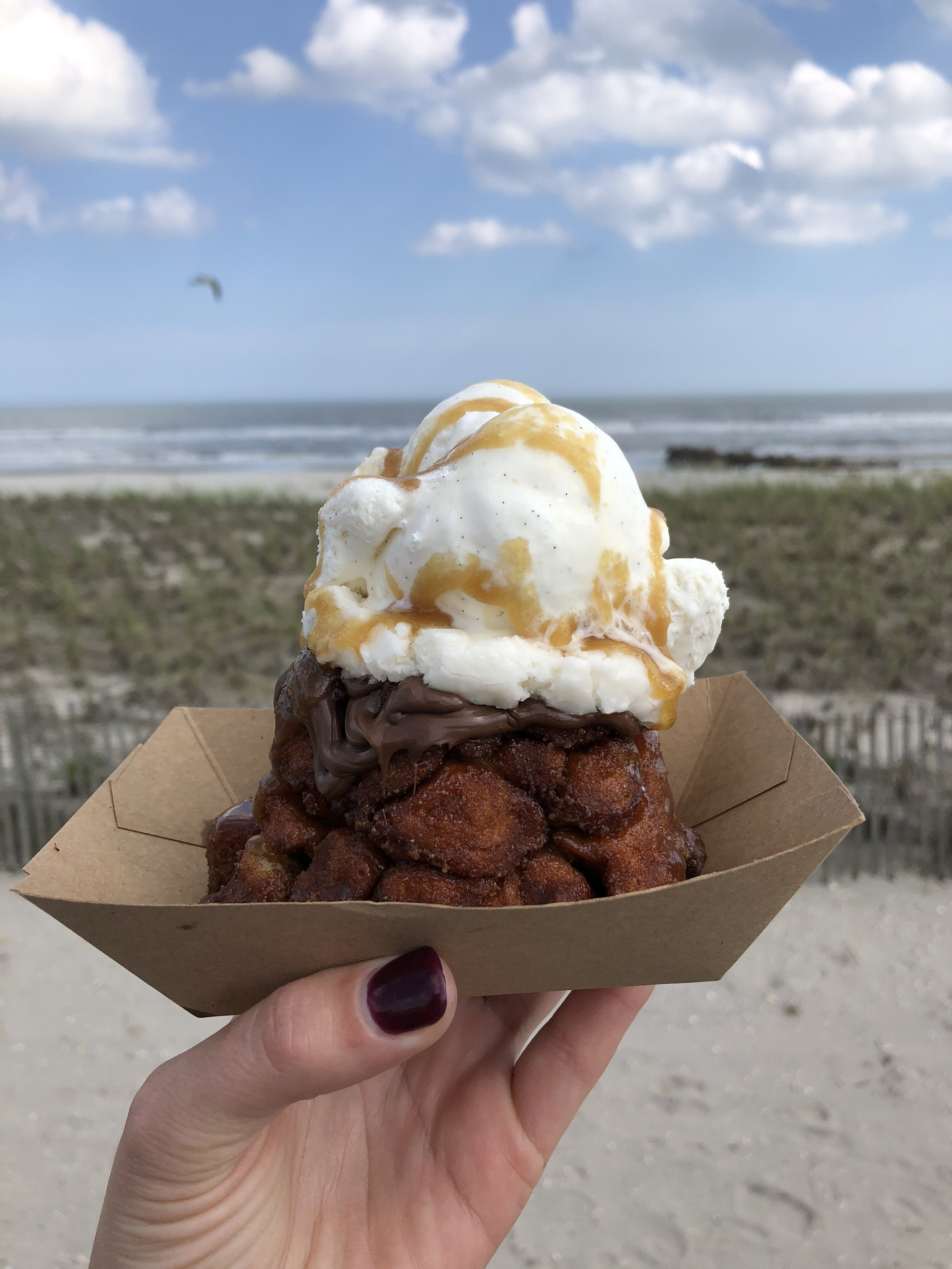 "Monkey Bread Sundae - warmed Monkey Bread of choice, with Vanilla Bean Ice Cream & topped with our signature ""goop"" topping that we use to bake the monkey bread."