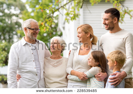 stock-photo-family-happiness-generation-home-and-people-concept-happy-family-standing-in-front-of-house-228539485.jpg