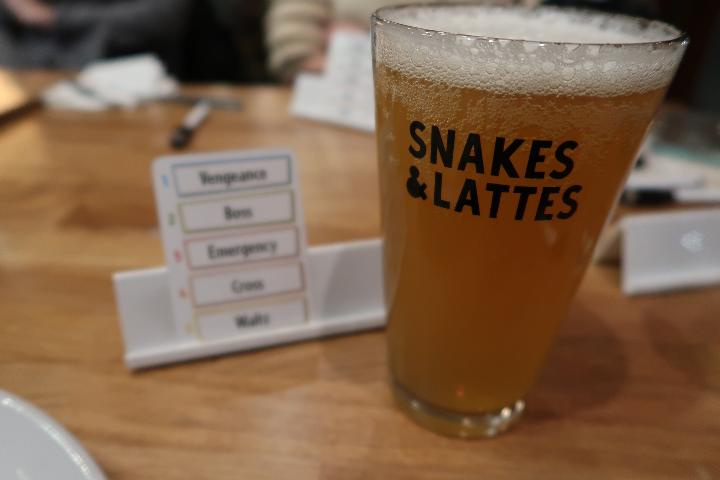 Beer and board game at Snakes and Lattes