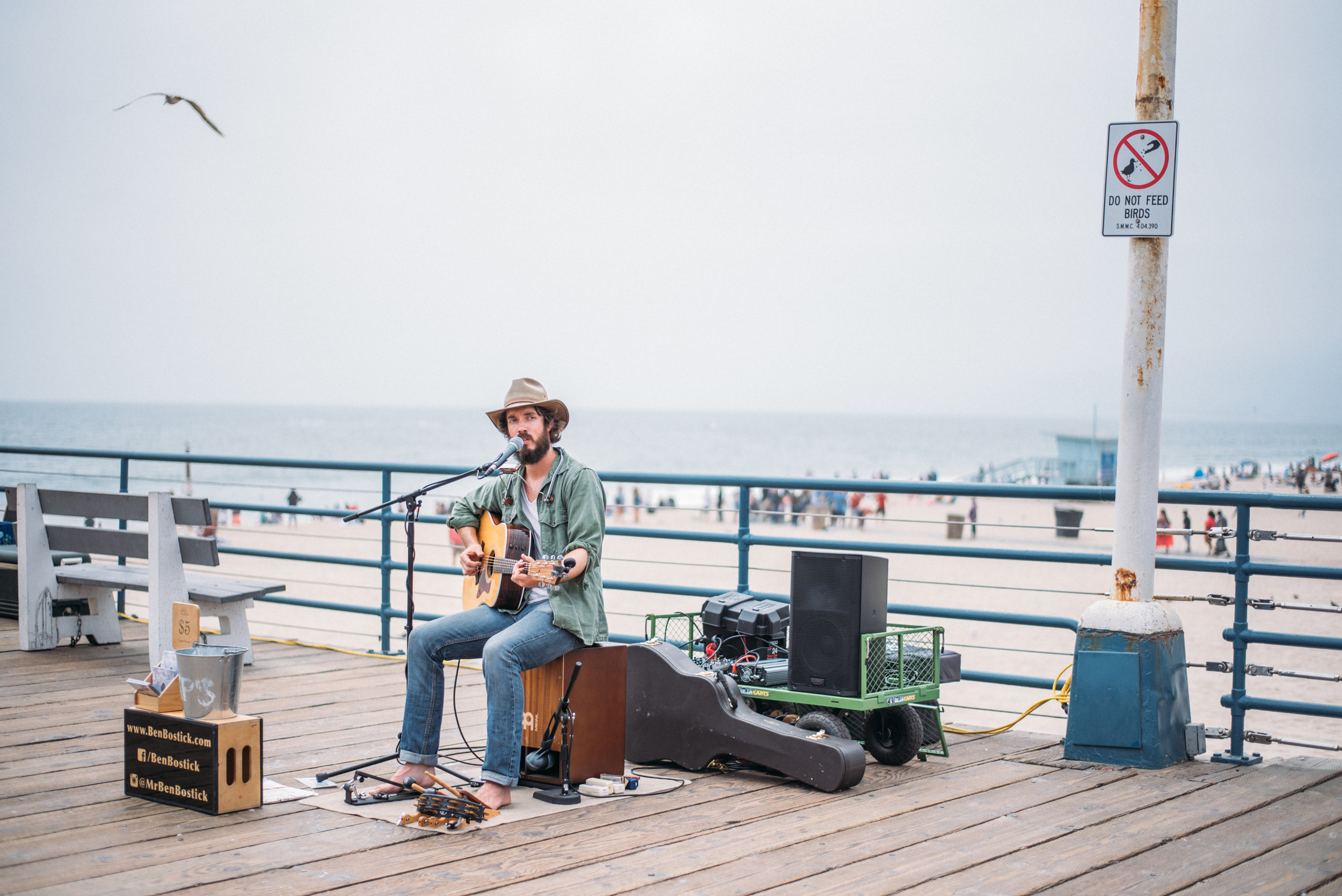 Tell Your Story - This next photo is of a performer here at the Santa Monica pier. He doesn't look posed, contrived, or awkward at all because he's in his element. He's himself. What speaks in this photo is the raw emotion and pain that you can see in his face and how expressive he is in this one shot. Had this been a posed portrait of him 'pretending' to perform, the story and emotion would have been lost.