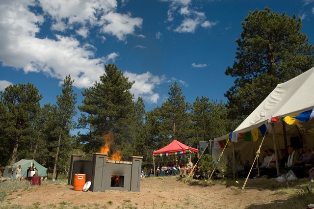 Preparation for an open air cremation at the private pyre at Shambhala Mountain Center. Photo by Corey Kohn