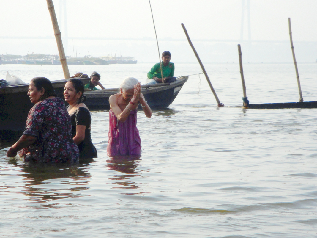 women bathing in the Ganges at the sangam