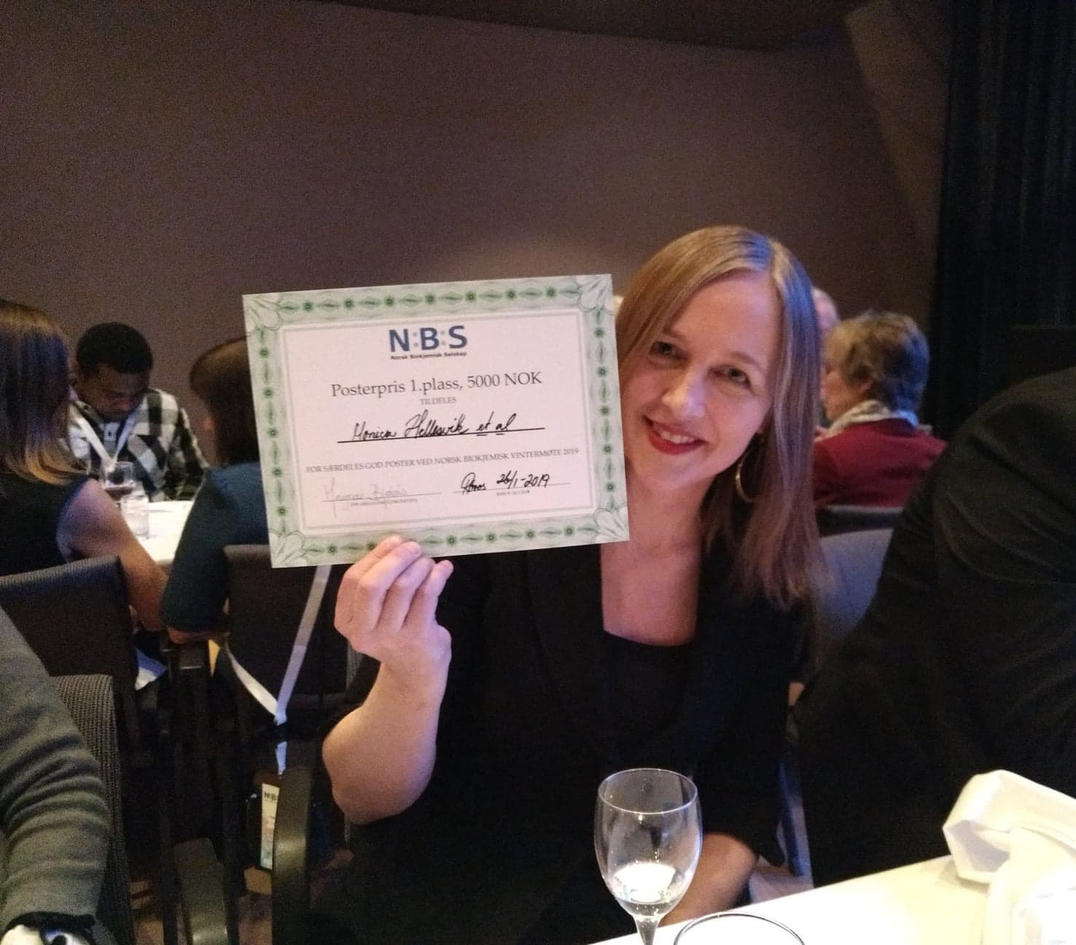 Surprised first place winner of the poster award, Monica Hellesvik, Master student in the Arnesen Lab.  Photo: Arnesen lab