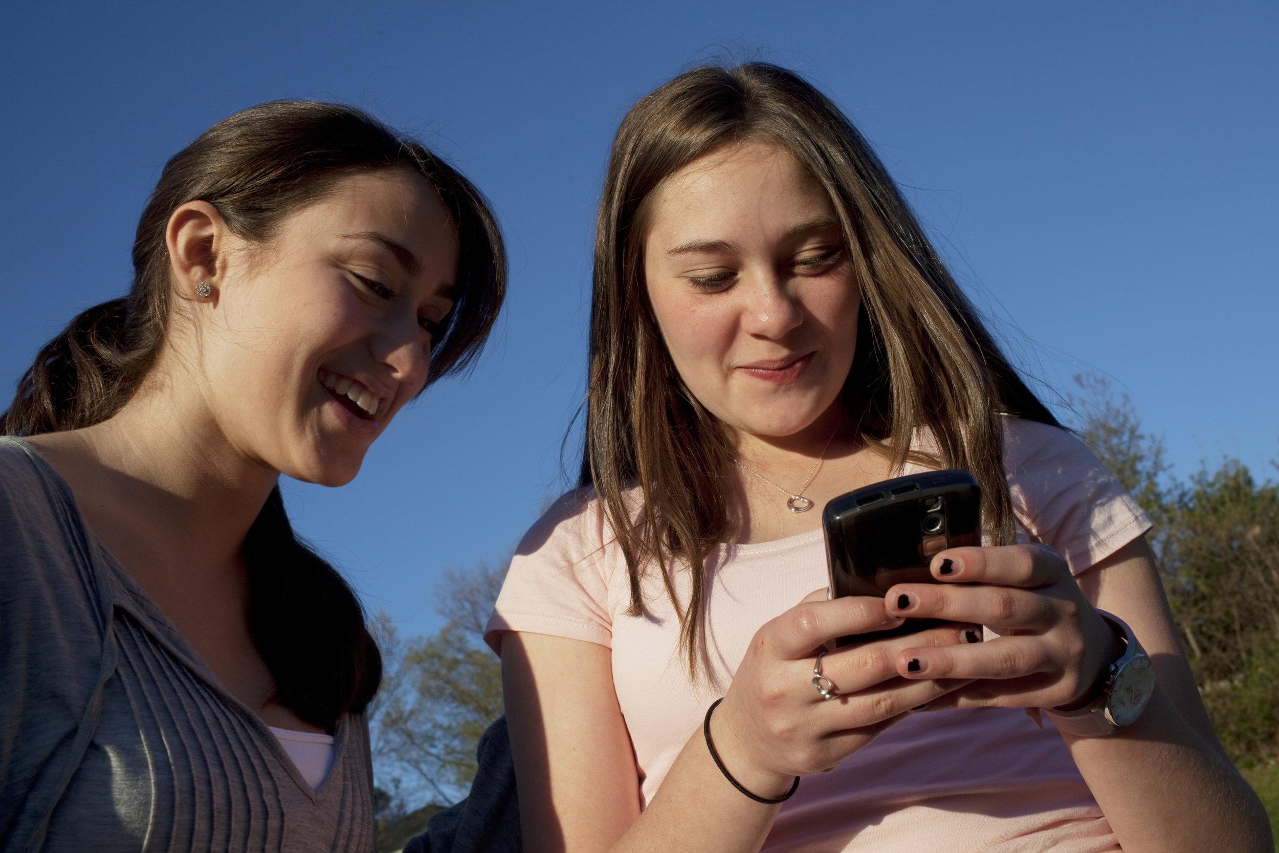 Two Teenage Girls Playing with Phone.jpg