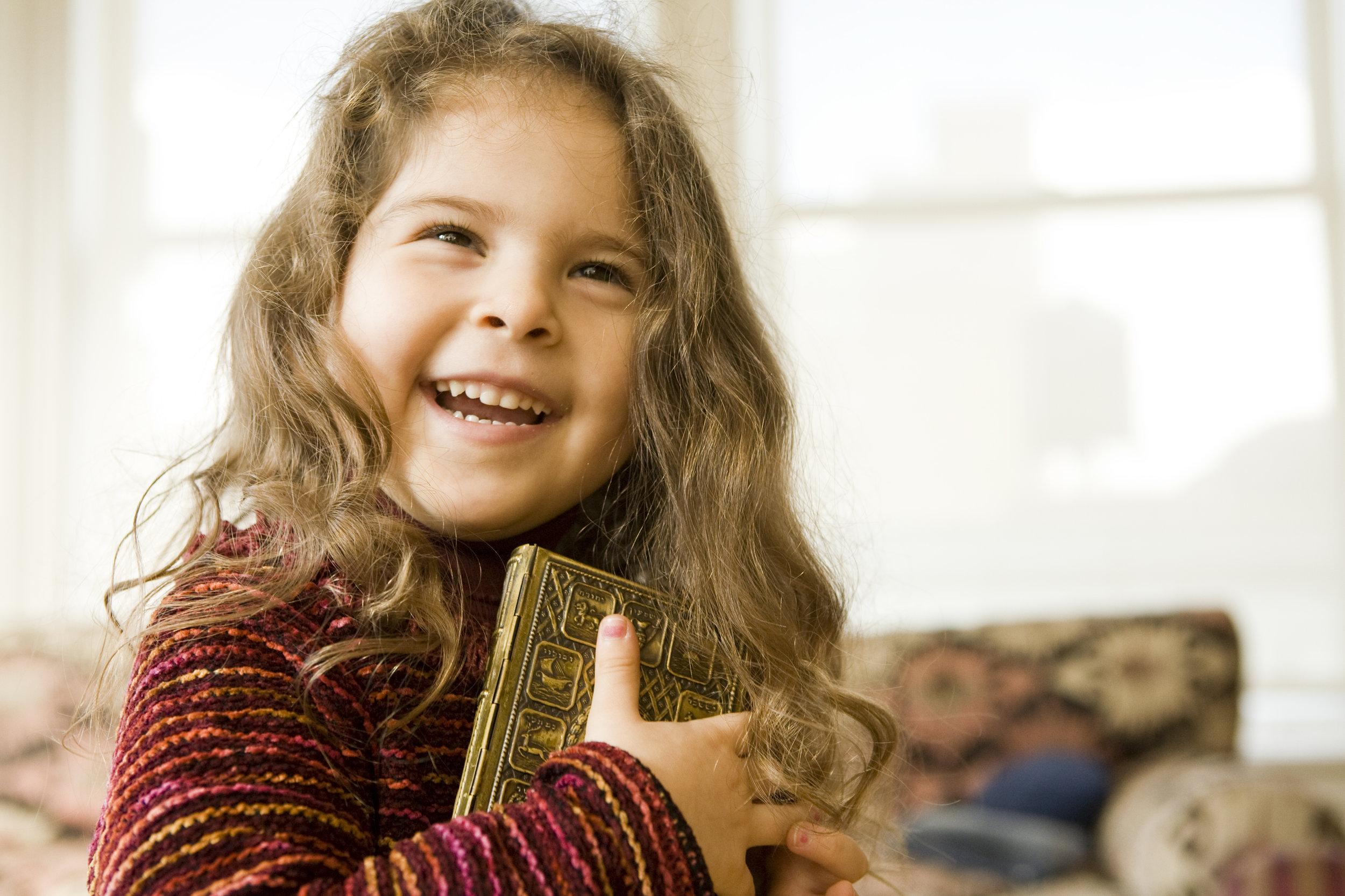 Laughing, Smiling, Girl Hugging a Prayer Book.jpg