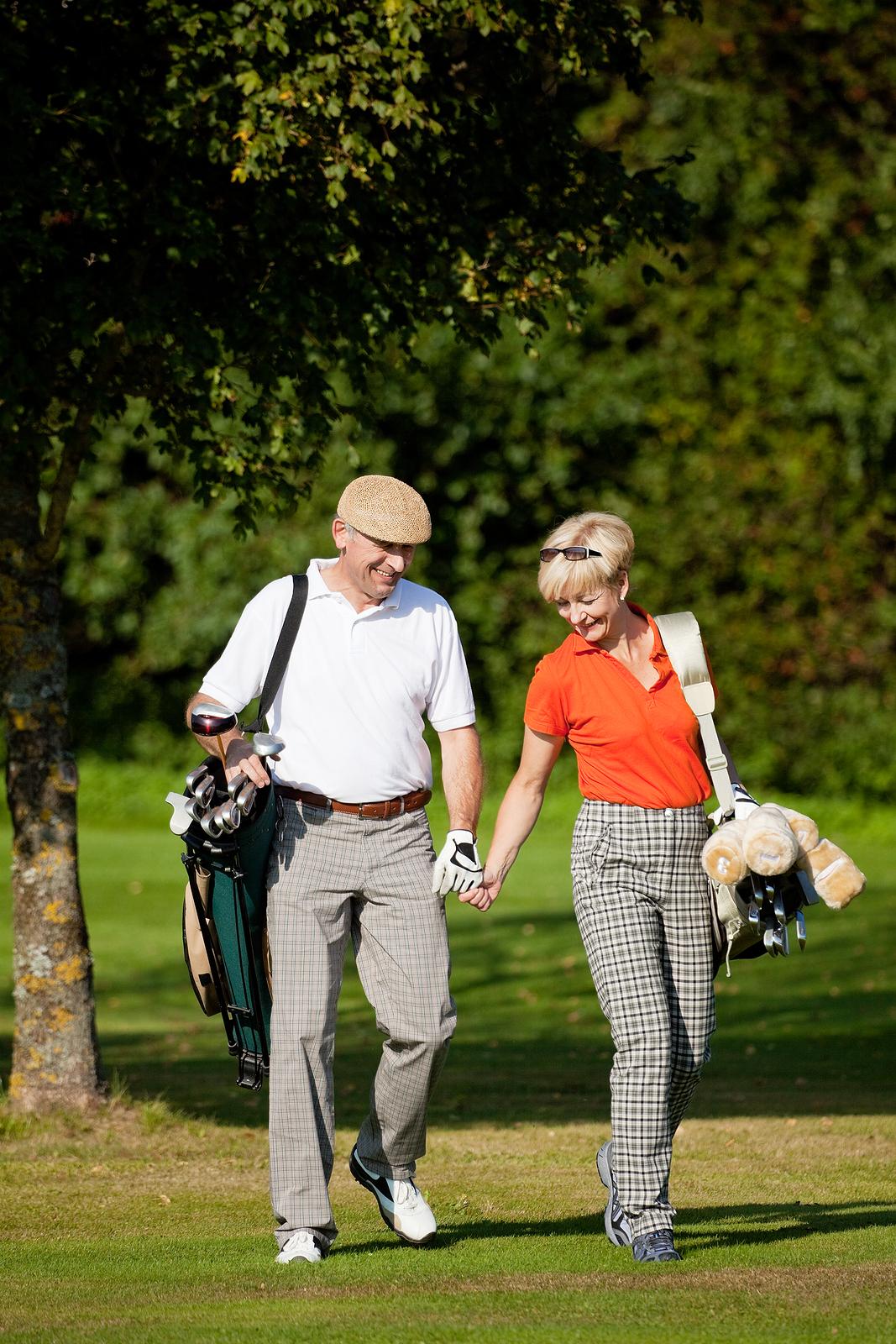 bigstock_Mature_couple_playing_Golf_6562894.jpg