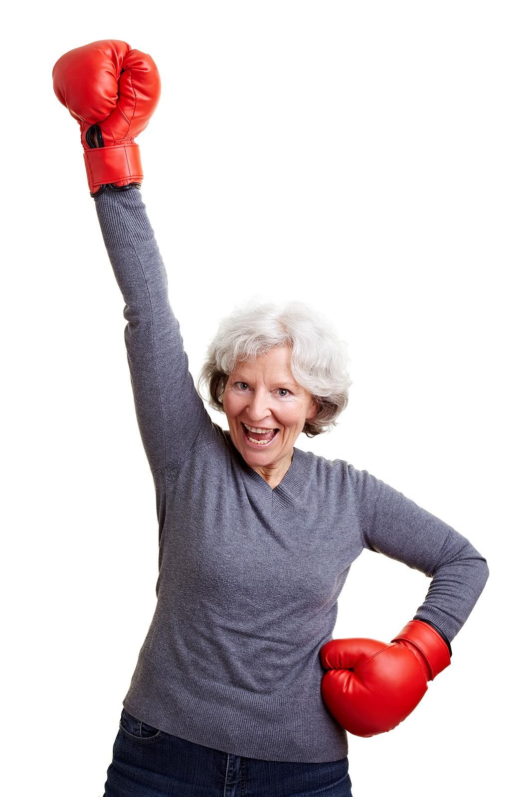 bigstock_Senior_Woman_Cheering_With_Box_14909687.jpg