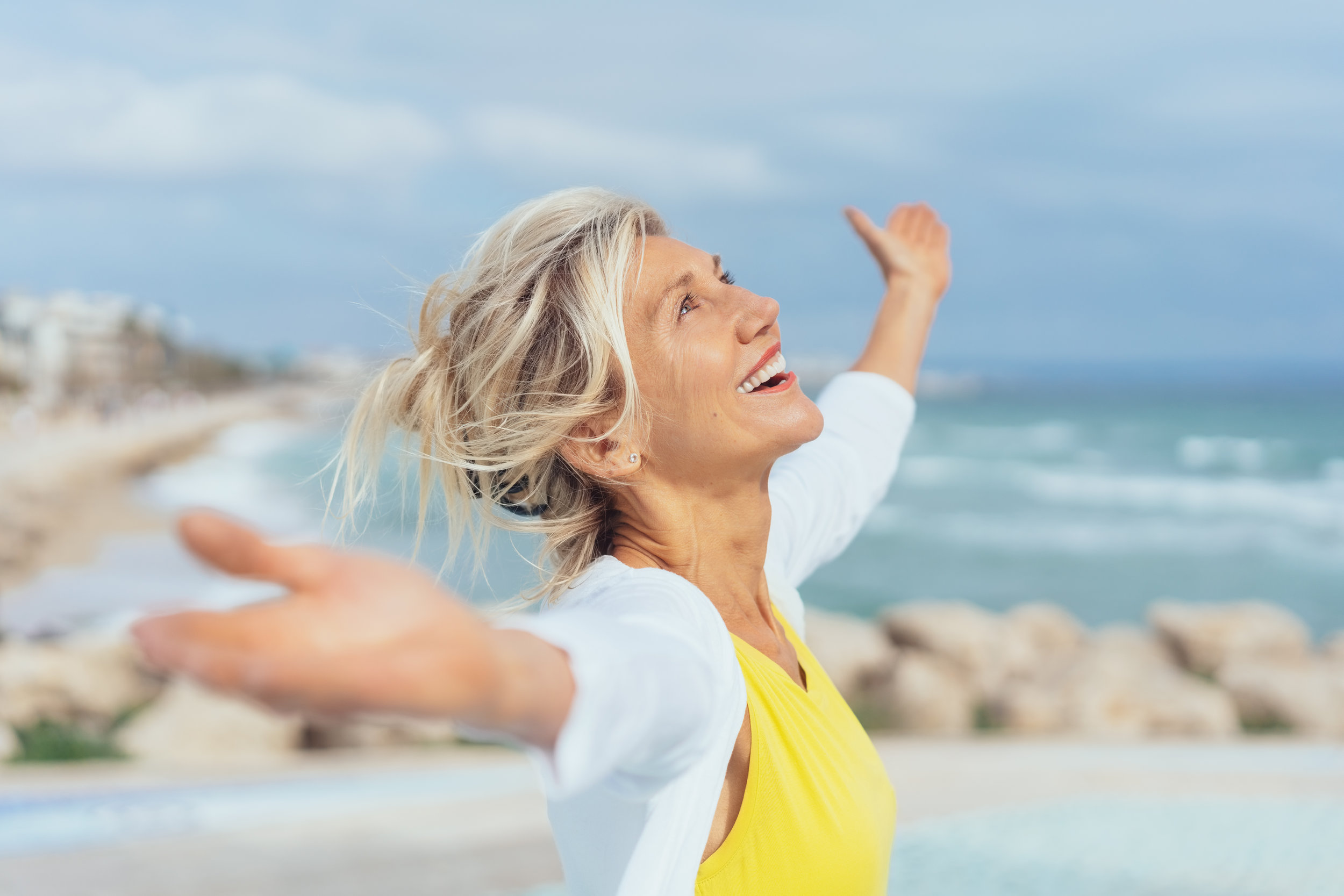 woman outstretched arms shutterstock_1115755928.jpg