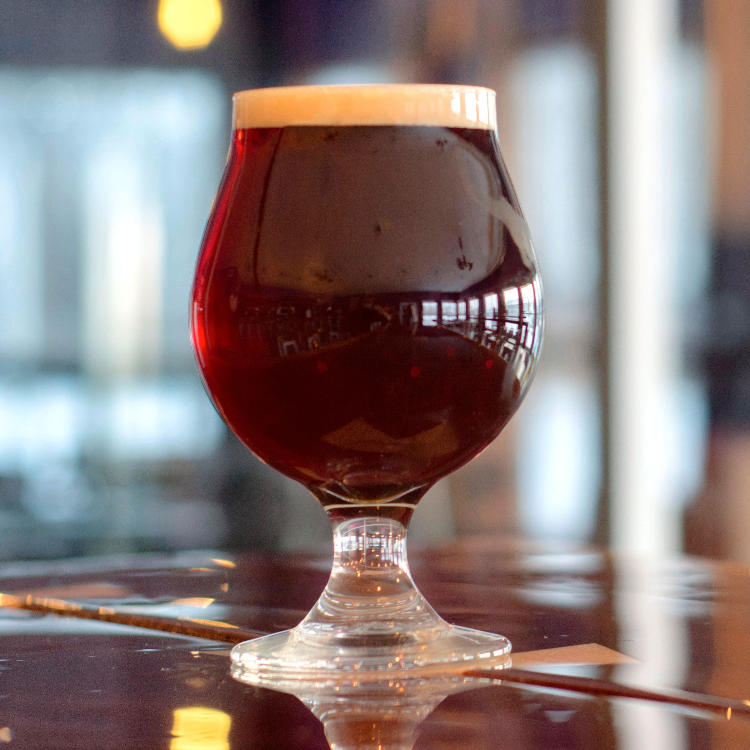 """Seiche Scottish Ale (say-sh) - """"Wee-Heavy Scottish Ale"""" 8.6% ABV, 20° Plato, 14.3 IBU Our Strong Scottish Ale has a rich and malty sweet flavor with ever-so-slight bittering provided by East Kent Goldings hops. Seiche is clear and coppery in appearance, with a medium mouthfeel that understates the alcohol content. Named for an oscillating wave, similar to a tidal wave, that occurs in enclosed or partially enclosed bodies of water after atmospheric disturbances... a marine phenomenon that has been documented on Lake Erie as recently as January 2019."""