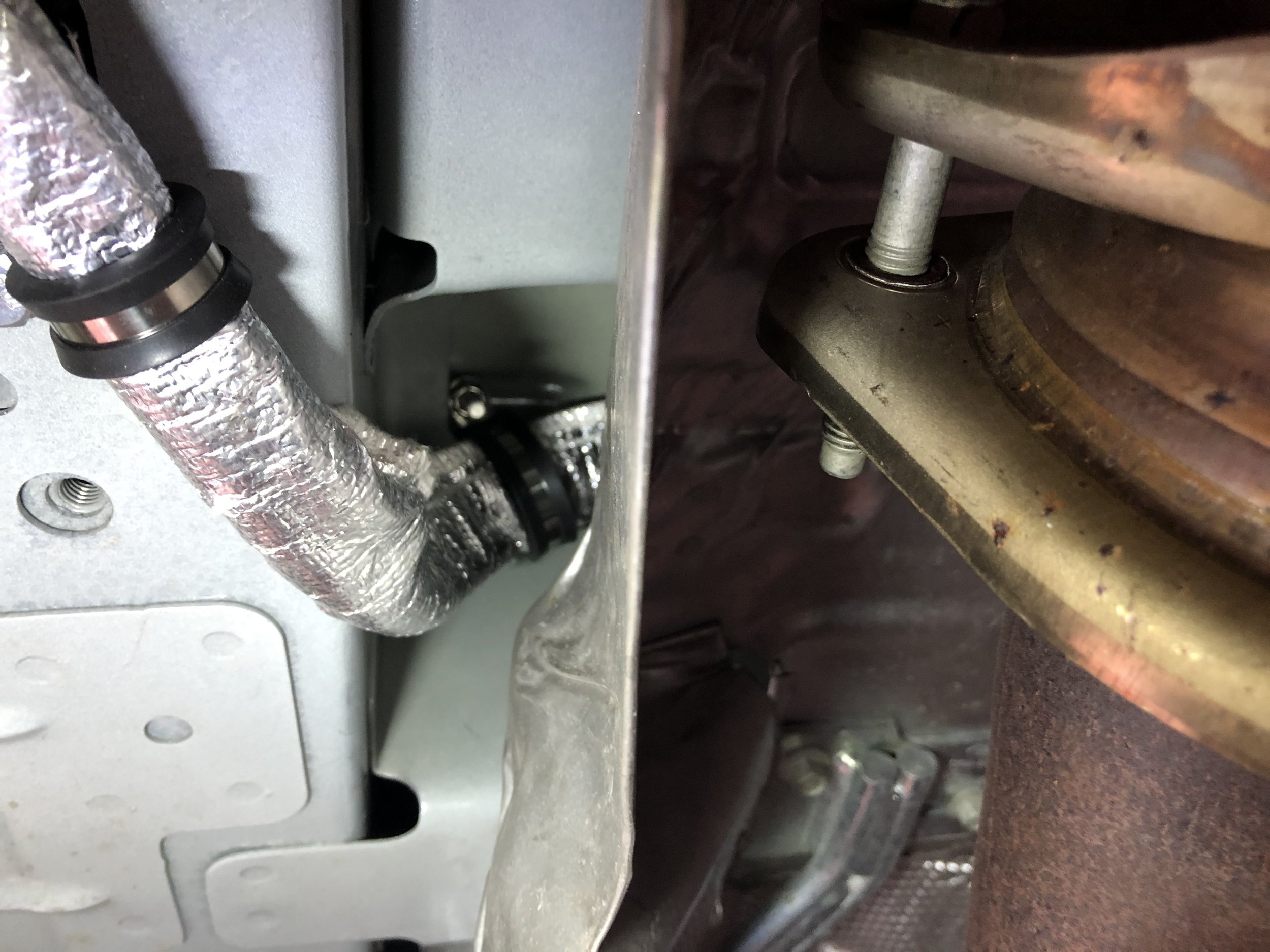 Clamp holding line off of exhaust