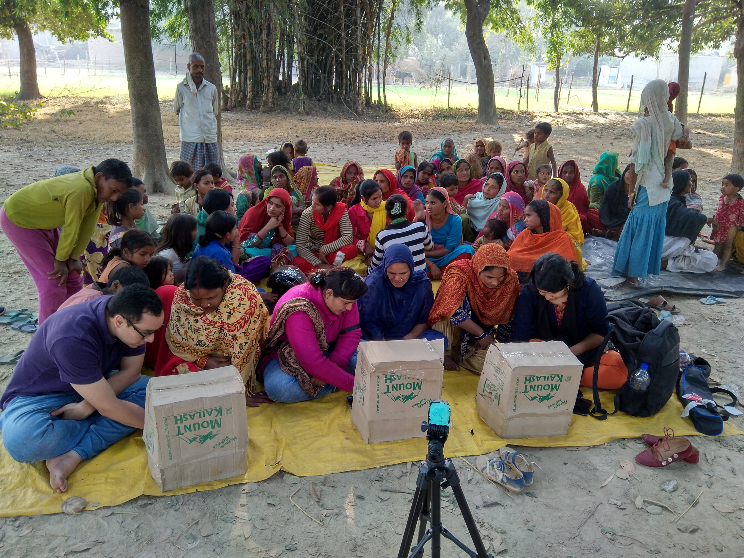 Women in Bahraich, Uttar Pradesh, guided by IDinsight Associates Andres Parrado and Ishita Batra, share their preferences on banking, savings, and loans as part of data collection.