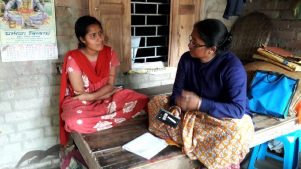 An IDinsight officer interviews a community member in West Bengal on her experiences with Aadhaar.