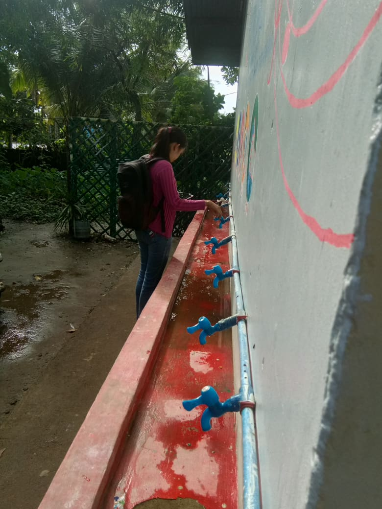 Camarines Norte Enumerator inspects handwashing facility4.jpg