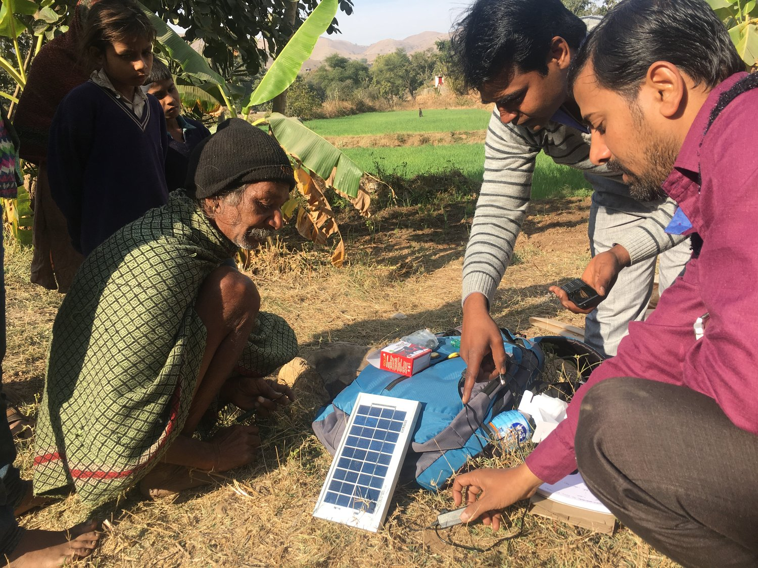 A farmer in Rajasthan learns how to set up and charge his mobile phone as part of the Data-on-Demand survey.