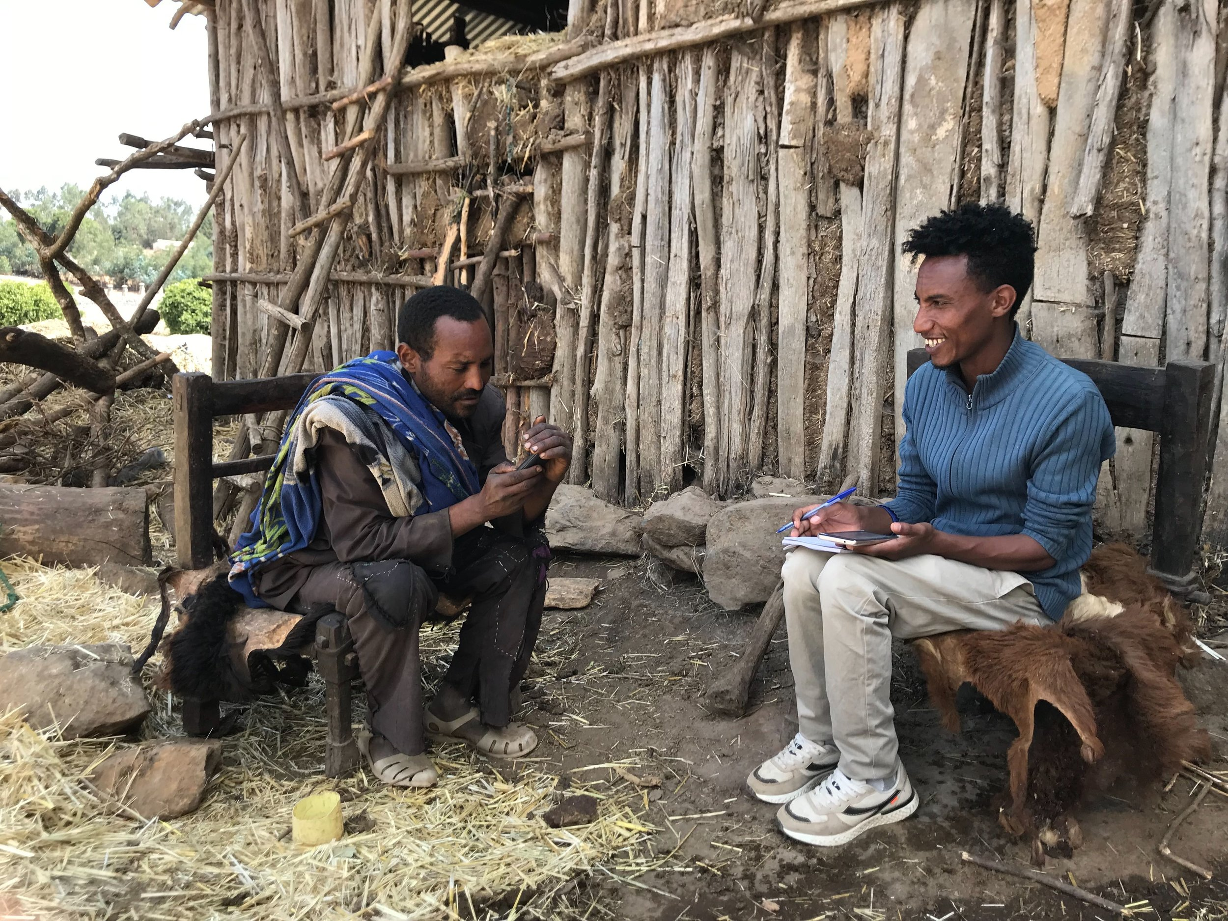 Markeshaw Dessie, an IDinsight data collector (right) conducts a survey about asset ownership in Wogera district, Amhara, Ethiopia