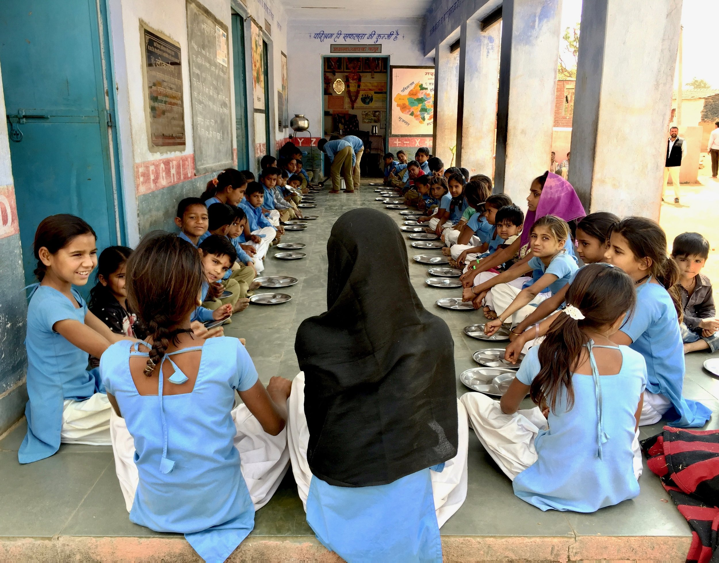 Students sit down for lunch in Jahajpur Rajasthan, where IDinsight evaluated the world's first Development Impact Bond.