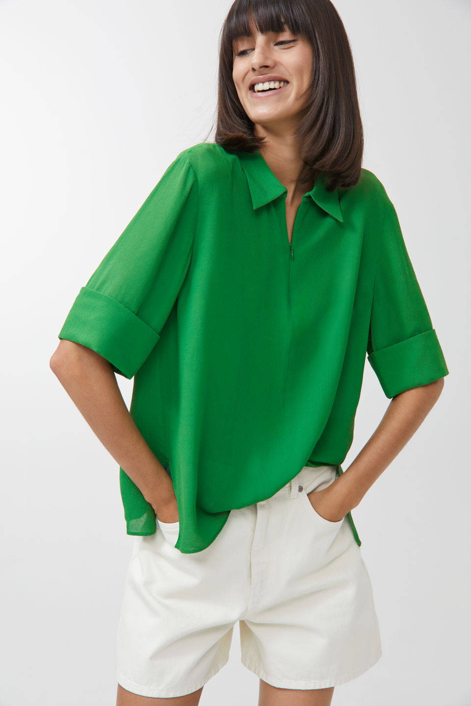 This crepe zip neck top at Arket is so cool I love it.