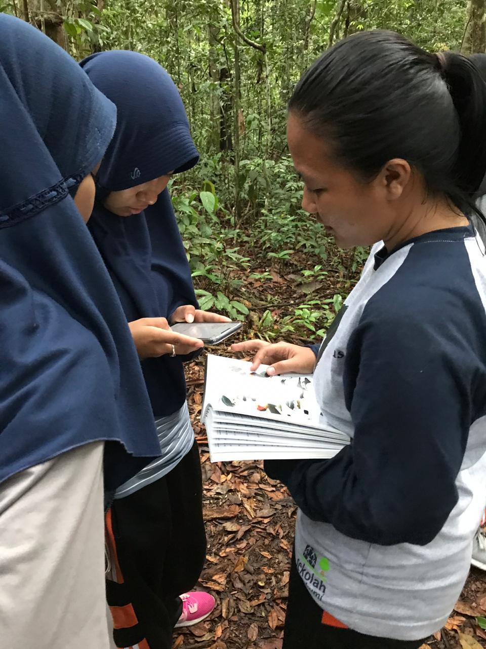 Local high school students using traditional and new ways to identify species.