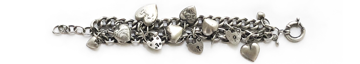 sterling vintage puffy hearts charms bracelet.jpg