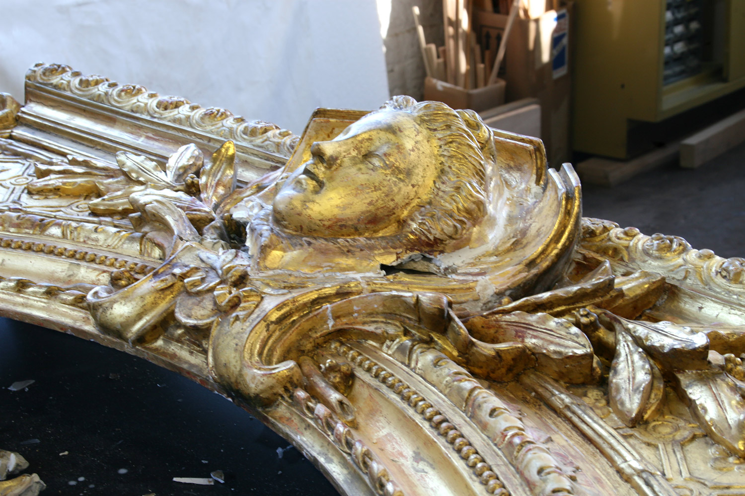 Gitwood frame conservation in progress - the center gilt figurative element was reattached