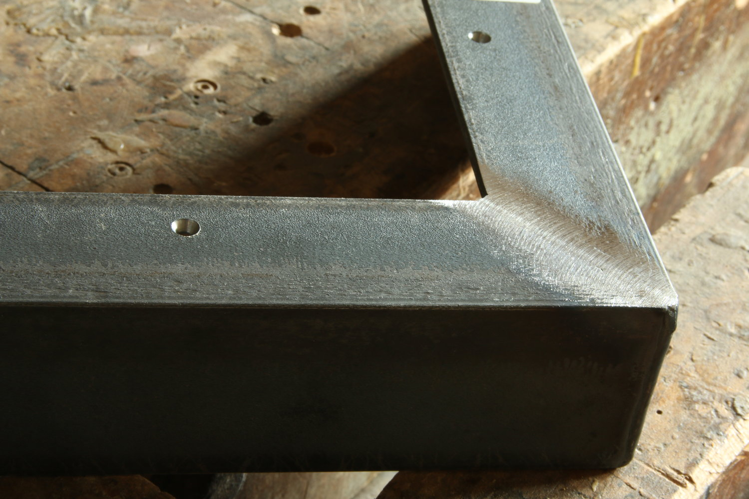 Smoothed seam butt joint weld on the frame face. The butt joint is created where two surfaces butt up against each other creating a single plane surface.