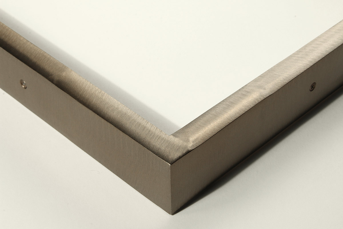 "Detail of a 5/8"" wide molding steel frame with zirconia bronze finish"