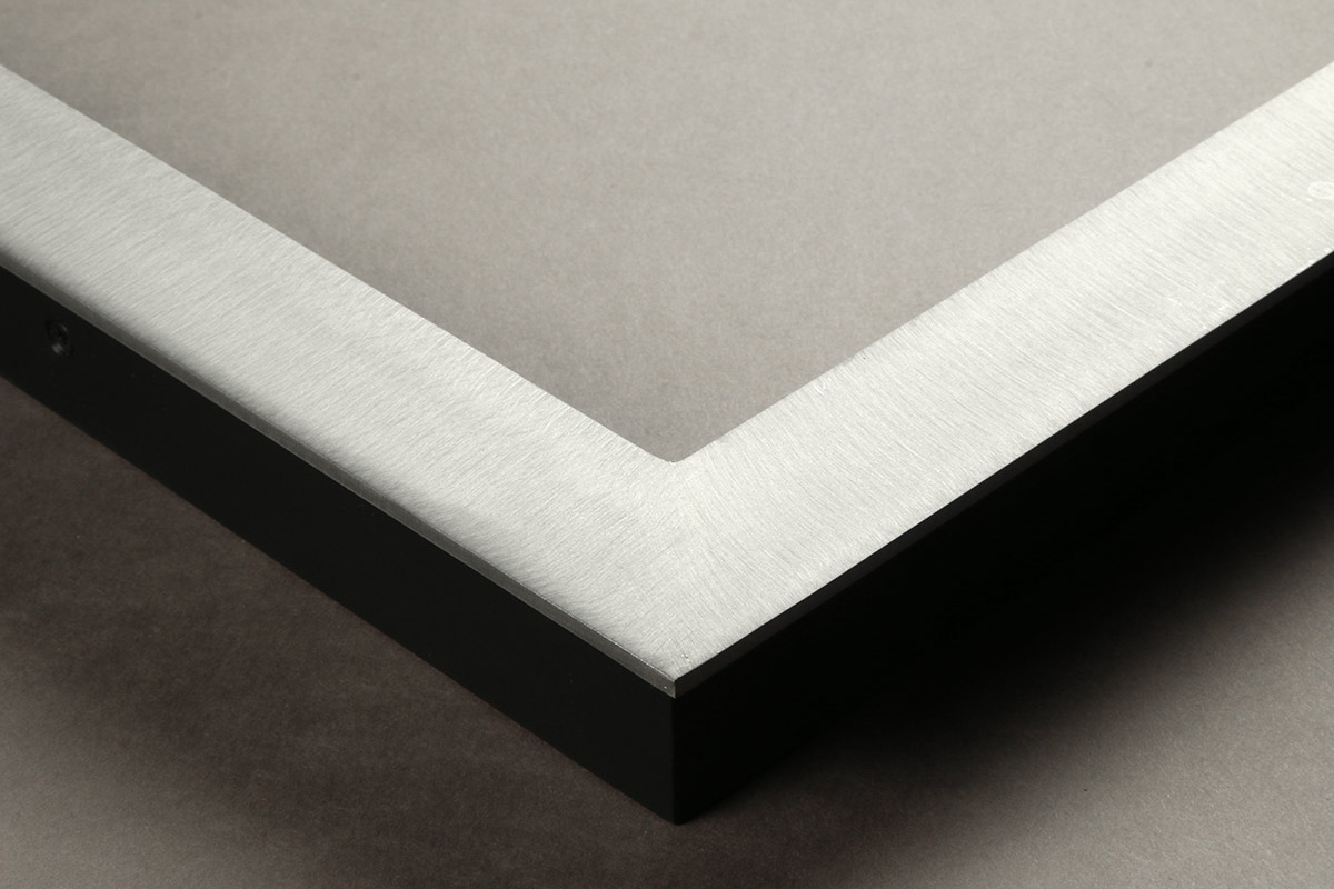 "Detail of an 1.25"" wide molding steel frame with brushed satin finish"
