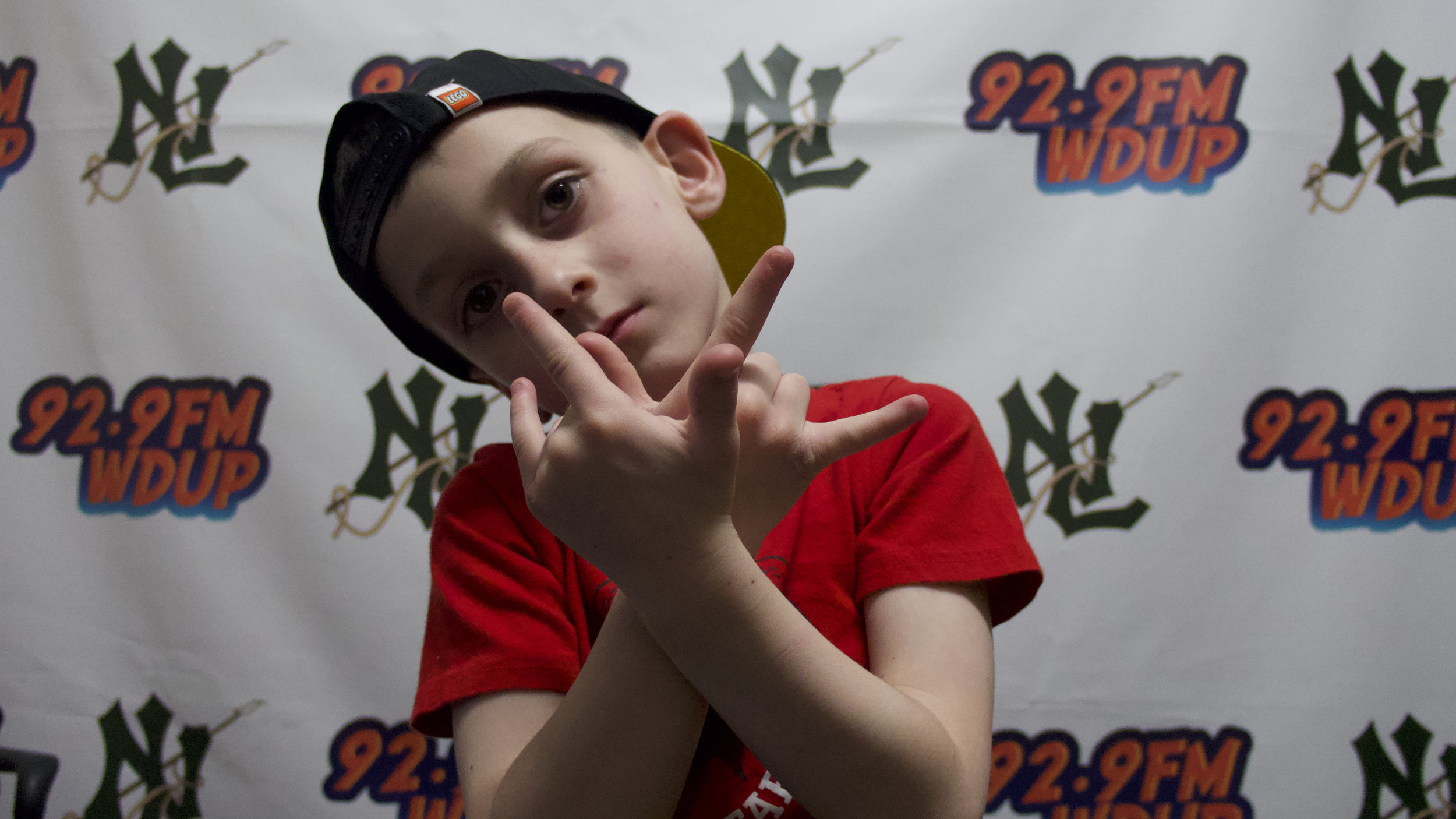 """Introducing New London, Connecticut's very own single-digit rapper, the show-stopping """"King Cay""""! This 7 year old phenom brings life to any stage & lights up every room he walks into, his energy is off the charts and performance demands a standing ovation. Wether you watch or listen to King Cay, he is sure to steal your heart and make your day! -"""