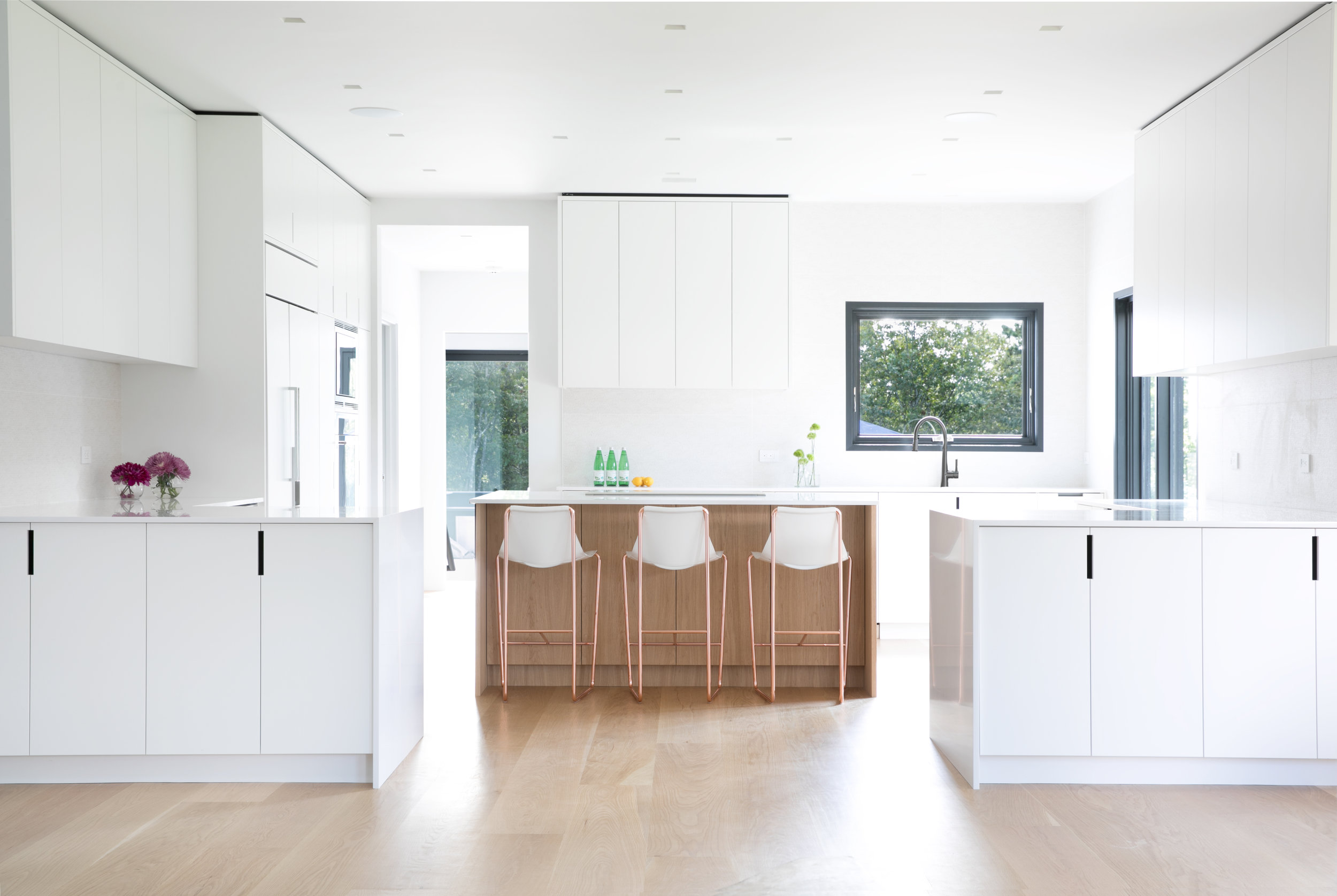 All White Kitchen Design with Wood Accents