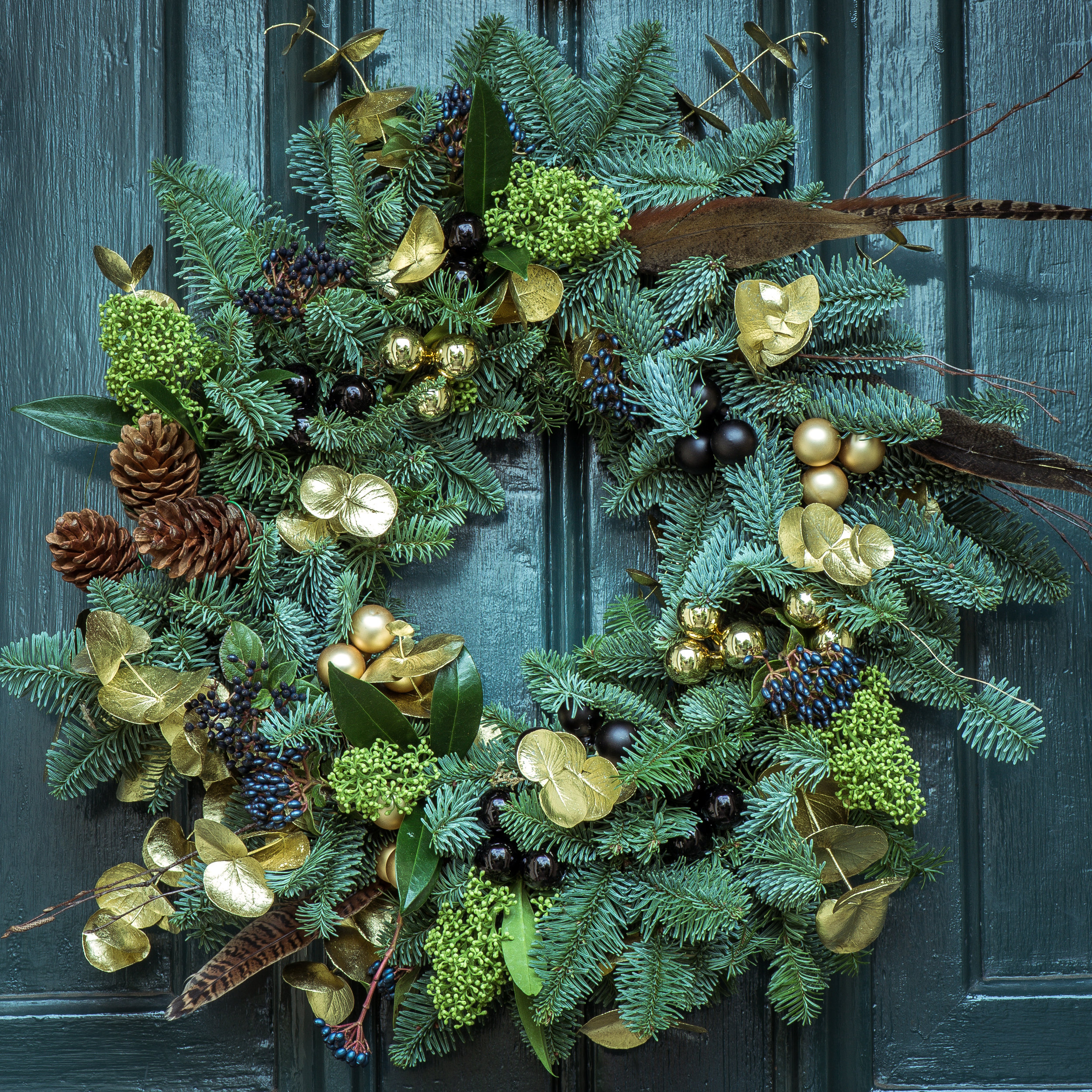 "INTRODUCING HANDMADE AT THE WEDGE - OUR WREATH ROOM IS BUZZING WITH WREATHS, SWAGS, BLANKETS AND MUCH MORE MADE FROM OUR FRESH CUT GREENS. IT DOESN'T GET FRESHER THAN ""HANDMADE AT THE WEDGE!'"""