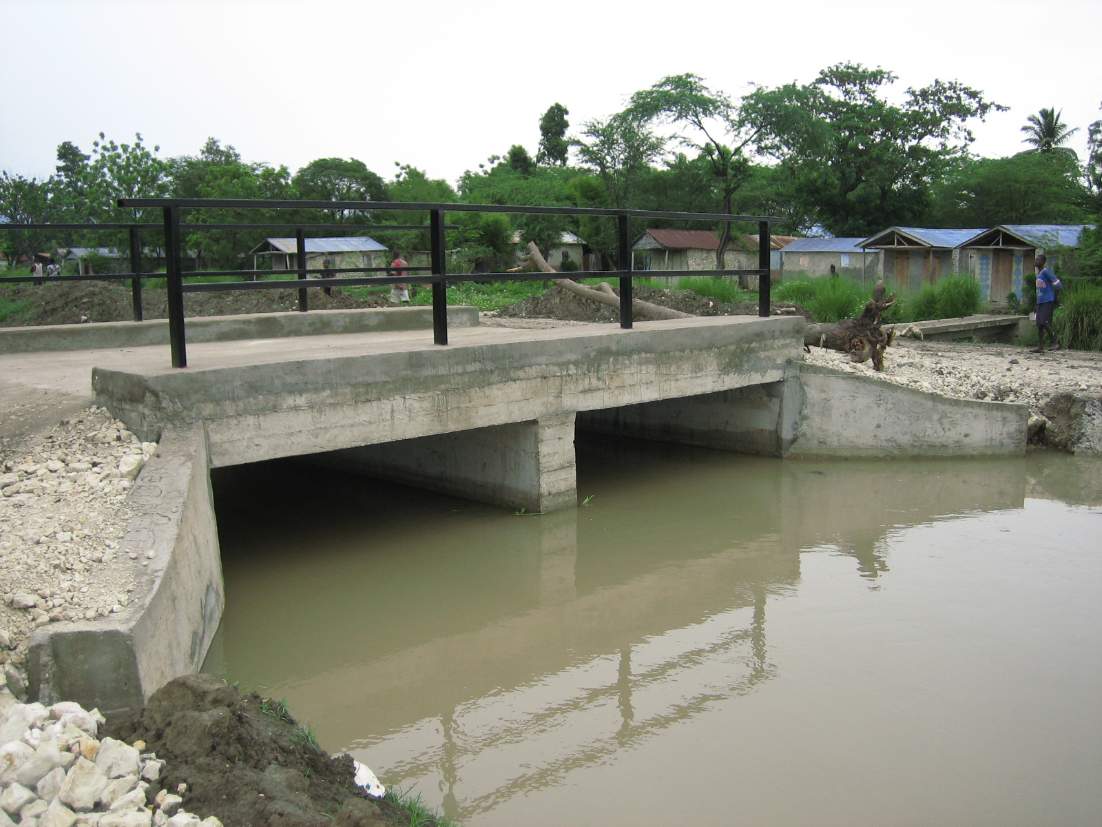 INFRASTRUCTURE -  In 2009, HTH built a concrete, vehicular bridge, greatly increasing the potential for the people to attend church, school, and the local well for their daily water supply. In 2012 HTH built latrines for the old Notre Dame Grade School and in 2013 a community center was completed, providing a place for meetings, seminars, social gatherings and computer classes.