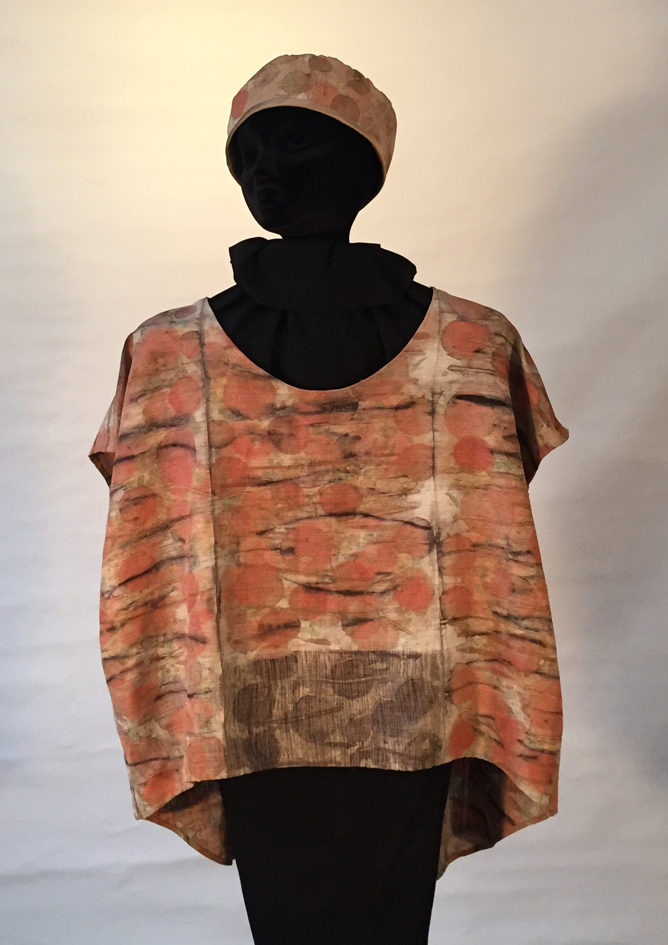 carefully placed fragrant eucalyptus leaves and twigs on her hand sewn silk designed top