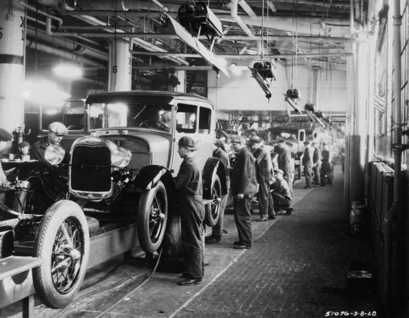 Assembly line workers inside the Ford Motor Company factory at Dearborn, Michigan. (Photo by Hulton Archive/Getty Images)