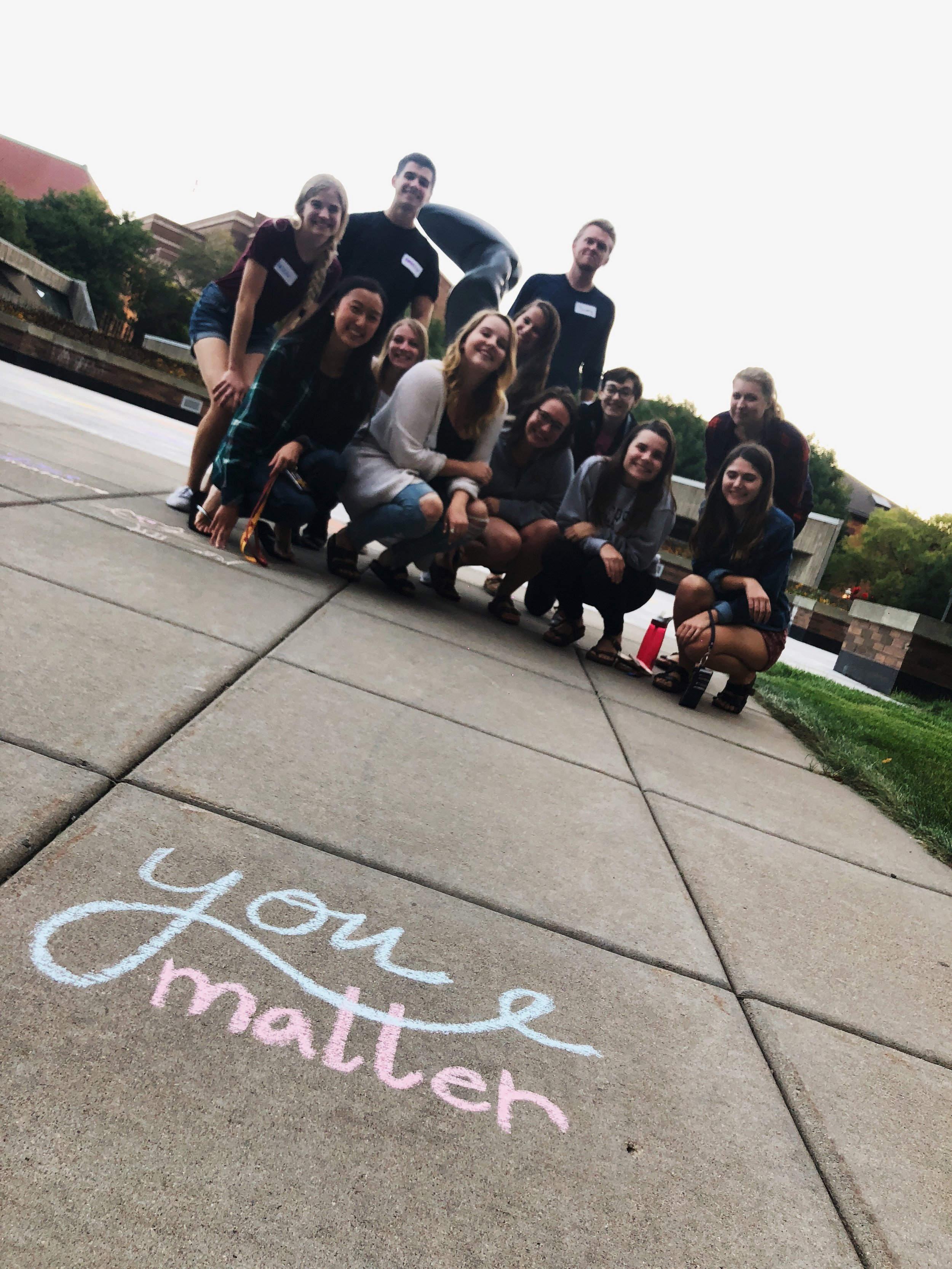 YOUmatter members after chalking up some motivation on campus